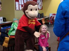 Relationships with local businesses pay off when a Delafield bookstore arranged for Curious George to come to the library (Judy Becker)