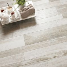 Recreate the popular vintage look in your own home with our new Driftwood collection. As the name suggests, this range is inspired by washed-up timber and the weathered, worn surface will give your floors an instant lived-in appeal. Unlike natural wood planks, these tile planks are made from durable porcelain so they're hard-wearing, easy to clean and you can use them safely in kitchens and bathrooms.