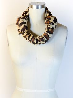 You've never felt more chic than you will when you have a scarf boa around your neck! Learn how to tie it!