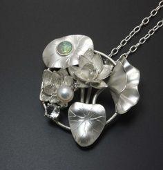 Lotus silver pendant with opal quartz and cultured pearl by KAZism. (C) Kazuhiko Ichikawa