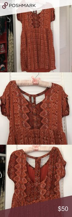 Free People Summer Dress Beautiful brick orange with white and black design. The dress is babydoll style with buttons in front and a t-back. Perfect condition, only worn a couple times. Slightly oversized fit. Free People Dresses Mini