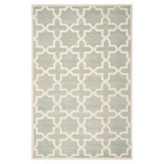 """Anchor your living room seating group or define space in the den with this artfully hand-tufted wool rug, featuring a geometric trellis motif for eye-catching appeal.    Product: RugConstruction Material: WoolColor: Grey and ivoryFeatures:  Hand-tuftedMade in IndiaPile Height: 0.63"""" Note: Please be aware that actual colors may vary from those shown on your screen. Accent rugs may also not show the entire pattern that the corresponding area rugs have.Cleaning and Care: Professional cleaning…"""