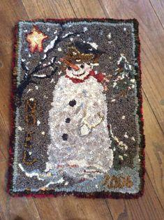 Noel snowman......cm.  Gosh, whose pattern is this?  So cute.
