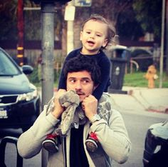 Flynn Bloom on daddy's shoulders :) with the bunny I'm going to get for my son if it's a boy! :) they'll be matchy ;)