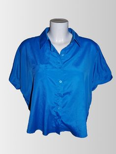 1980s Blue Cut Out Shirt from www.sixesandsevensvintage.com at £15.00  Size 12.