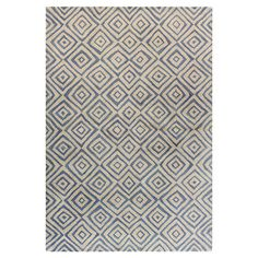 Hand-tufted wool rug with a tribal-inspired diamond motif.   Product: RugConstruction Material:  WoolCol...