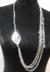 Blauwe lapis lazuli en zilveren blad