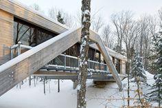 Beautiful cedar-clad Bridge House crosses a ravine in Ontario