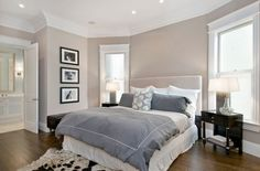 Bedroom: dark wood floor, gray duvet, white linens