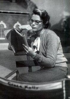 Grace Kelly studies her script between takes, 1950s.