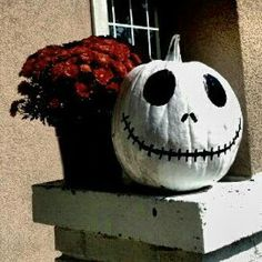 Jack Skelington Halloween pumpkin but instead of painting actually cut out the face