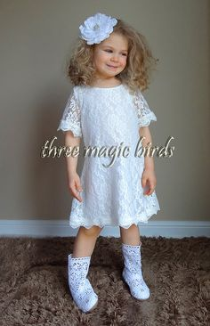 This cute lace kids short sleeve dress in white (ivory) is worthy a princess! Lovely vintage flower girl lace dress for summer, fall, winter and spring wedding or birthday party, whether it is a picture day or simply attending a special event with this soft lace girl dress! Back zipper. Fully lined.  ♥.•¨¯`•.♥ ¸¸.•¨¯`•.♥ ¸¸.•¨¯`•.♥ .•¨¯`•.♥ ¸¸.•¨¯`•.♥ ¸¸.•¨¯`•.♥.•¨¯`•.♥  Please be sure to read our policies before checkout!  NEW FB FANS RECEIVE A 15% OFF DISCOUNT PURCHASES OF $20.00 OR MORE…