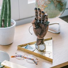Need a hand with storing your favourite jewellery? Try this sophisticated wooden holder standing on a golden metal tray #hipster #ilovetrends #keeptidy #doiy #design