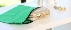 Green envy clutch cover by Kazzi Kovers. Fun way to organise your closet and protect your handbags.
