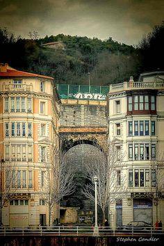 Bridge behind tall buildings in Bilbao, Basque Country,  Spain