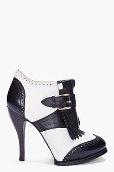 Black & Ivory! Classy! Wing Tip and Baroque, adjustable buckle closure and tassel detail & a tapered wooden stiletto heel. Alexander McQueen you still reign King! Forever your Fan!