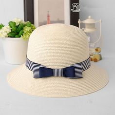 Blue and white striped bow sun hat for women summer wear