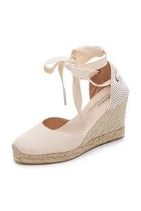 Soludos espadrilles with a solid toe cap. Two-tone heel cap and wide ankle ties. Wedge heel. Braided raffia sidewall and rubber sole. Fabric: Canvas. Made in Spain. This item cannot be gift-boxed. Measurements Heel: 3.25in / 80mm