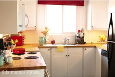 white cabinets with butcher block, cottage style, ikea cabinets, budget kitchen makeover