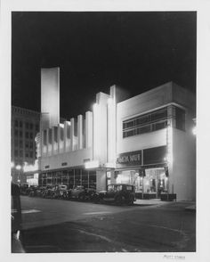 Nighttime in LA, 1935.  losangelespast:    Looking northeast on Cahuenga: the Owl Drug Storebuildingin Hollywood on a clear night in 1935.