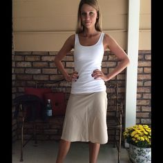 """Tan A-Line Skirt - NEW LISTING Super Simple, Super Cute, Super Deal!! Perfect in any wardrobe... Tan Aline skirt, has a side zipper that works perfectly. Skirt is in Great Pre-loved condition. Skirt measurements : across waist laid flat approx 13"""" and length approx 23"""" ... Skirt has a slight stretch for a comfy fit. Forever 21 Skirts A-Line or Full"""