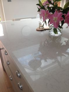 Pale Grey Shaker with Silestone 'Lagoon' worktop.