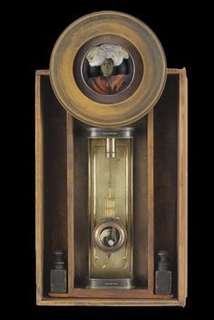 """Victoria Kamamalu Artist Kass Copeland 26""""h x 13""""w x 6""""d  Mixed media assemblage, candlestick, grand-father clock parts, wooden plate, hand-tinted vintage image"""