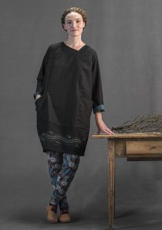 Ebba dress Our stylish wool dress with an embroidered border is both rustic and modern at the same time. Angled neckline, raglan sleeves and inset pockets are just some of the details featured in this dress.