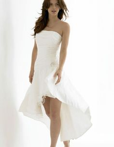 DARE TO BARE  For the bride that dares to bare. The short dress is back and is set to stay. There is a misconception that a short wedding dress is less formal than the longer variety. The current dress collections are proving that the designers are committed to dispelling this belief. A short dress can be classic and chic. Variations on this trend are waterfall effect dresses that are shorter at the front than they are at the back.