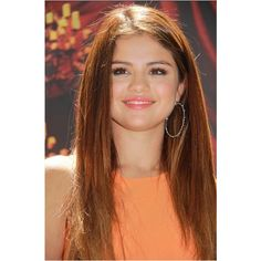 Selena Gomez with orange hair! ❤ liked on Polyvore featuring selena gomez and mlu