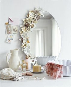 Flower mirror. Flower everything. Paint some pink Full: 46 Ways to Decorate Your Dorm on the Cheap via Brit + Co.