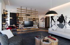 TV divider wall with shelves http://www.homedit.com/wall-mounted-tvs-and-shelves/