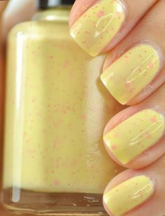 Yellow nail polish with pink speckles!  This would be sooooooooooooo pretty for Easter!  I love these nails!