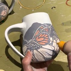 Excellent Screen pottery mugs beginner Ideas Glazing a sgraffito pottery mug – monarch butterflies and coneflowers Sgraffito, Glazes For Pottery, Ceramic Pottery, Pottery Art, Ceramics Pottery Mugs, Painted Ceramics, Painted Pottery, Painted Mugs, Pottery Sculpture