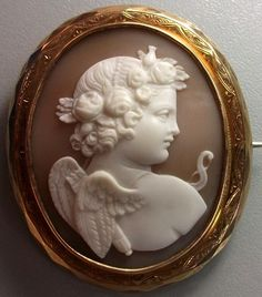 Sardonyx Shell Cameo of Eros (Cupid in Roman Mythology), 1870.  All the symbols of Eros are shown, his bow and his quiver full of arrows to break the hearts.  http://www.antiquecameos.net/