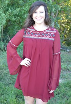 MAROON CHIFFON DRESS  43.00 What a beautiful dress! The see through chiffon, bell shaped sleeves with the stitch detailing make this a gorgeous dress! It looks perfect paired with booties and leggings, too!