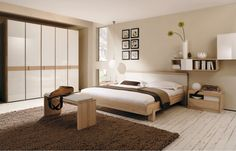 Elegant Room Decor For Beige And White Themed Bedroom Design Ideas With Minimalist Brown Wood Bed Frame That Have Mattress Simple Wall Shelf Complete The Picture Frames Accessories Also Smooth Bedside Table On Flooring Ball Shaped Lamp