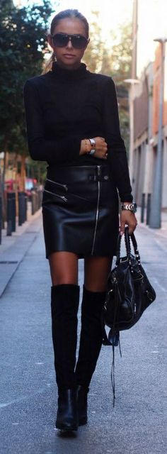 Maria Kragmann wears a pair of over the knee boots with a leather mini skirt and a turtle neck top; the ultimate rocker look. Top: American Vintage, Skirt/Boots: Zara, Bag: Balenciaga.