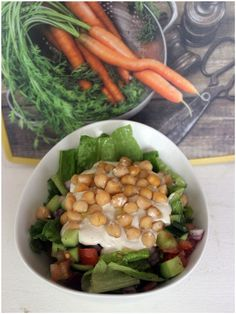 Yummy salad with chickpeas and tahini on top