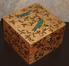 This small box measures approx. 6 x 6 x 4. It has been burned with 2 birds and vines with leaves. Colors have been added with oils. Polyurethane coating to protect it. Thank you for looking and have a look in my shop at a large selection of gifts, wedding items, custom, and personalized pieces. Layaway plan available. International clients please contact me for shipping rates.