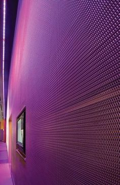 Visitors to the W Hoboken Hotel lobby are greeted by a glowing metal mesh wall.: