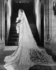 """Miss Florence Crane, daughter of Mrs. Richard T. Crane, Jr., and granddaughter of the founder of the plumbing supplies company, in her wedding gown when she became the bride of William Albert Robinson, traveller, and author, at her mother's home in Chicago"", 19 March 1933."
