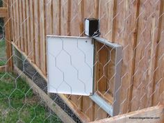 automatic chicken door--powered by solar panel and opens and closes from a light sensor