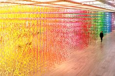 Forest of Numbers spans a 2000 square meter exhibition space and consists of over 60,000 numbers in 100 colors suspended, looking like binary code.