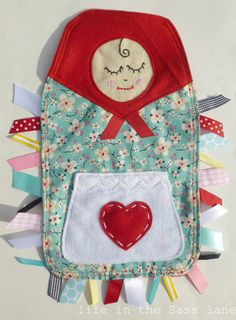 Babushka taggie!  For a Woods baby girl.  @Andie Woods