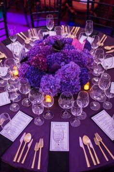 Two x Two for AIDS and Art Gala and Auction: The tables were color-blocked with linens and coordinating floral arrangements. The same gold flatware and clear glassware at each table tied them together.