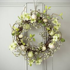 Welcome friends to your home with a dollop of spring cheer with our beautiful Easter wreath or garland.This gorgeous spring flower wreath is a simply stunning way to decorate your home for Easter, or just to give the feeling that 'spring has sprung'! With a verdant, over-grown effect that captures the feel of a real spring meadow, it's a truly breathtaking decoration that chases the last of the winter chill away in seconds.Twig, fabricWreath 35cm diameter