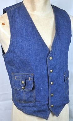 What the rebellious wore in the 70s to their office jobs! Originally from an all-denim, 3-piece suit; this vest makes for a hip wardrobe staple when paired with a t-shirt.