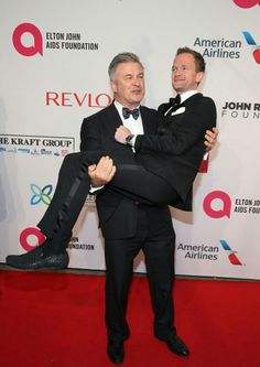 Neil Patrick Harris jumps on Alec Baldwin at Elton John's AIDS Foundation's 13th Annual Enduring Vision Benefit! October 28th, 2014.