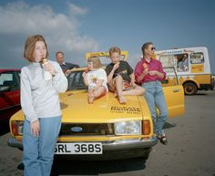 A family eating ice-cream around a parked yellow car, Image from Martin Parr's series From A to B, A Tale of Modern Motoring, Now on view at Autophoto Paris Social Photography, Flash Photography, Color Photography, Street Photography, Reportage Photography, Photography Projects, Martin Parr, Magnum Opus, Magnum Photos